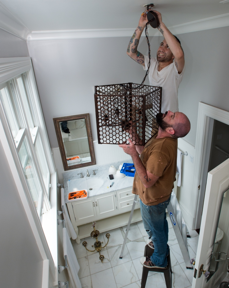Zaque Eyn (below) and Andy Mandel (above) of Gigi Park install a light fixture at a home being prepped for sale in San Francisco on Thursday, August 20, 2015. Many home sellers are waiting to list their homes until September; one of the hottest months of the year for real estate sales. (JOSH EDELSON / SPECIAL TO THE CHRONICLE)